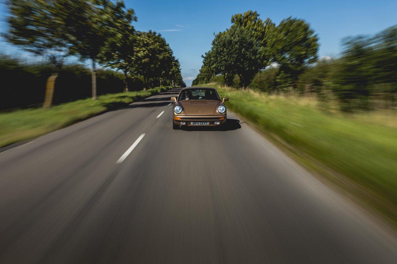 porsche 911 sc on road
