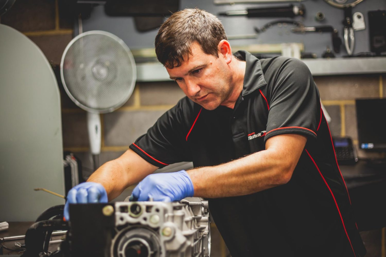 technician building porsche engine